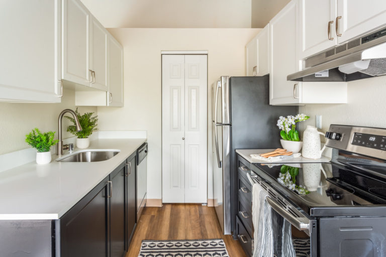 Stainless steel appliances and white cabinets in the kitchen.