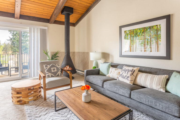 A couch with a wood burning stove make this living area comfortable.