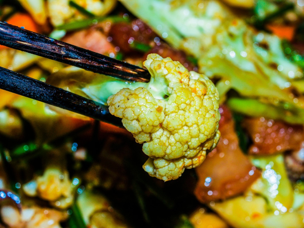 spicy vegetables with chopsticks