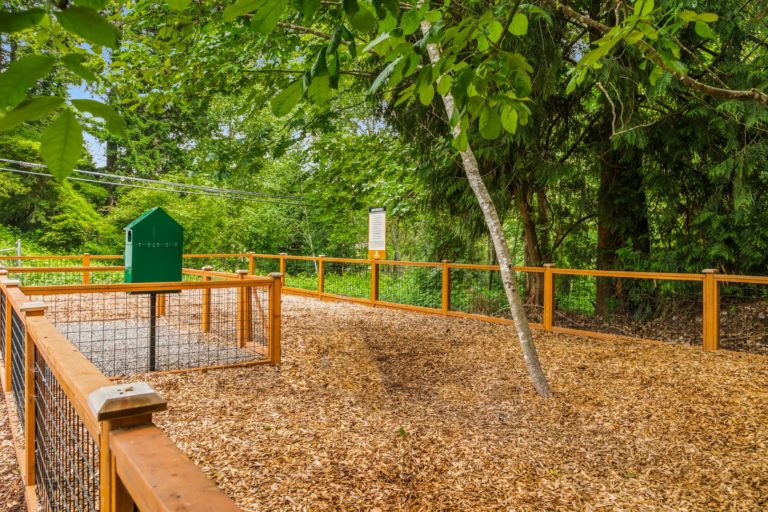 The off leash dog park at Timbers Apartments has Cedar chips.